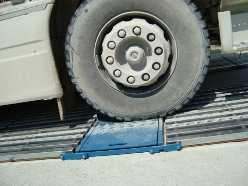 Portable__in_motion_axle_weigher_wheel
